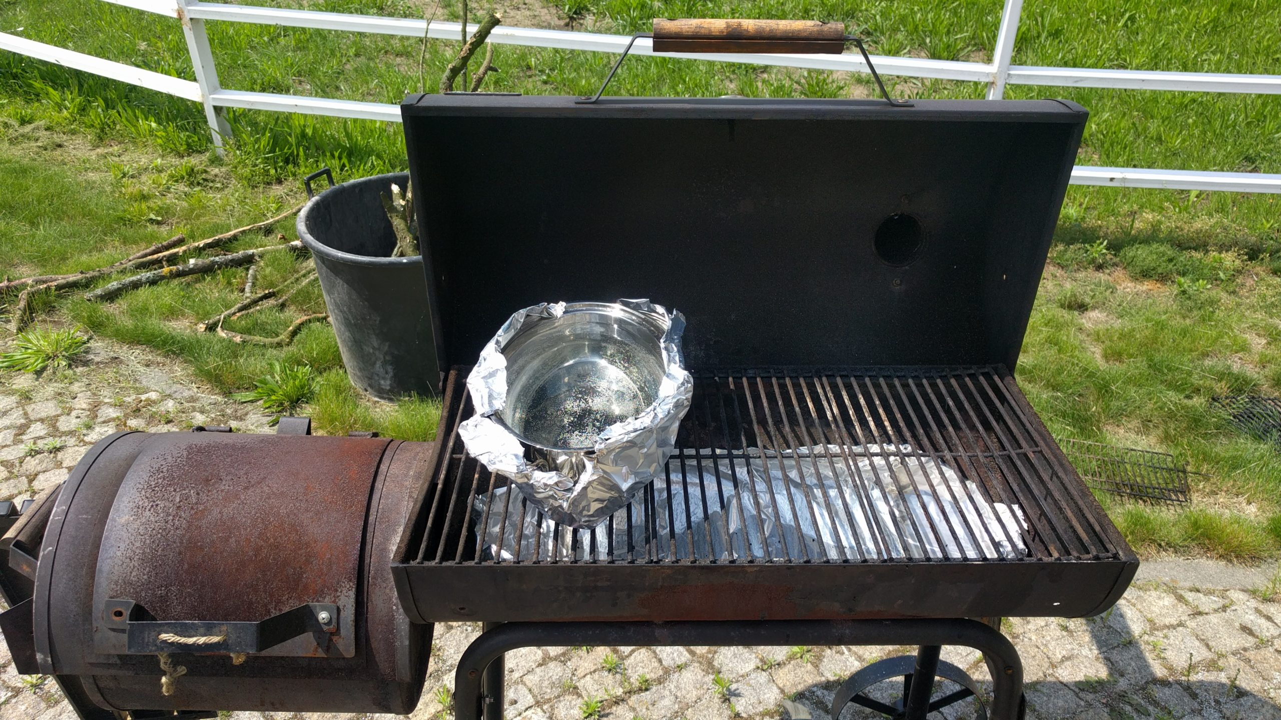 Drip pan and water pan ready in position to start smoking.